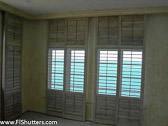 ShuttersSliding-shutters-partial-openShutters-Architectural-ShuttersShuttersSliding-shutters-partial-openShutters.jpg