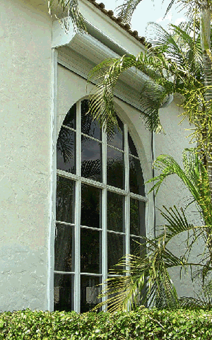 roll up hurricane shutter over arch window