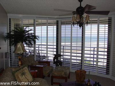 interior sliding shutters on curved opening